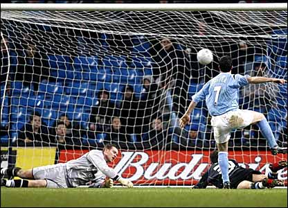 Manchester City striker Robbie Fowler scores the first of his three goals