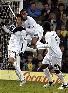 Jared Borgetti (left) is mobbed after scoring Bolton's opener at Watford