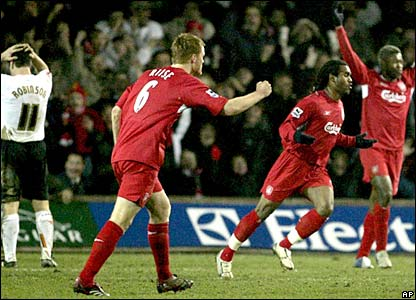 Sinama Pongolle wheels away from the goal after getting Liverpool back in the lead