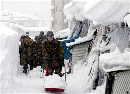 Soldiers help clear streets of snow in Iiyama, northern Japan