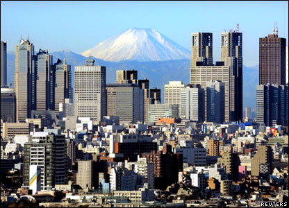 Snow-capped Mount Fuji seen above the skyscrapers of Tokyo