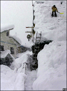 A man clears snow from his roof in Iiyama, northern Japan