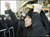 A woman holding the Koran on her head at a demonstration in Beirut, Lebanon