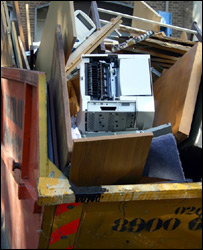Computer in a rubbish skip