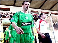 Roy Keane walks on to the pitch at Broadwood