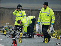 Police examine the scene of the crash near Abergele