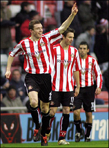Neill Collins (L) celebrates Sunderland's opening goal
