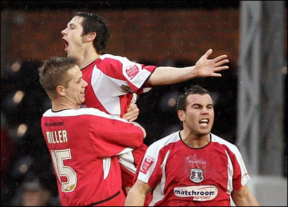 Joe Keith is lifted high by a team-mate after getting Orient's second goal