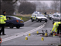 Police officers examine the fatal crash scene at near Abergele, north Wales