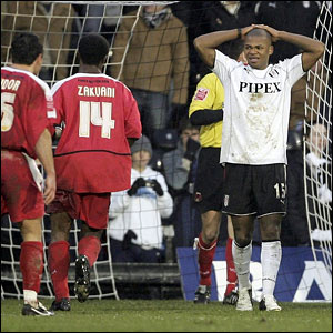 Collins John (R) reacts after his penalty is saved