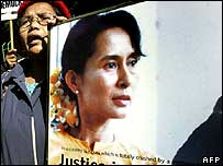 Woman holding poster of Aung San Suu Kyi