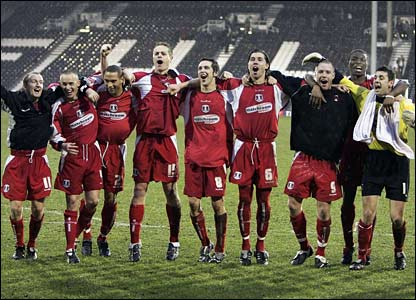 Leyton Orient's players salute their fans after victory