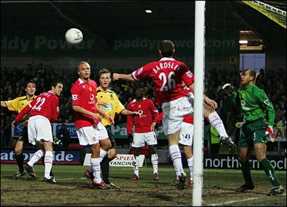United's Phil Bardsley clears Jon Shaw's header off the line