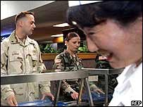 Soldiers line up for food at a US base
