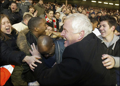 Barry Hearn celebrates with Orient's jubilant fans