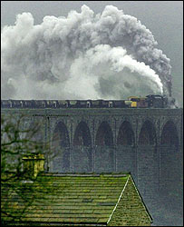Train crosses the Ribblehead viaduct