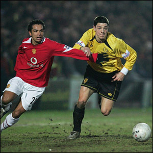 (L-R) United's Kieran Richardson and Burton's Chris Hall compete for the ball