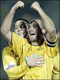 Burton skipper Darren Stride (right) and Chris Hall celebrate after drawing with Manchester United