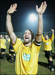 Burton captain Darren Stride leads his team in celebration