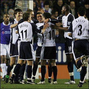 Jermaine Jenas is surrounded by his team-mates after scoring the first goal for Spurs