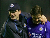 Leicester City boss Craig Levein (left) celebrates their FA Cup win over Spurs with  Nils-Eric Johansson
