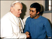 Pope John Paul II meets Agca in an Italian jail in 1983