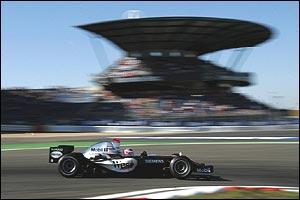 Raikkonen passes the Mercedes grandstand in his McLaren-Mercedes