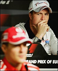 Ralf and Michael Schumacher in a news conference