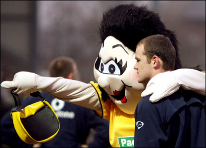 Manchester United's Wayne Rooney poses for photographs with Burton Albion's mascot before their FA cup encounter