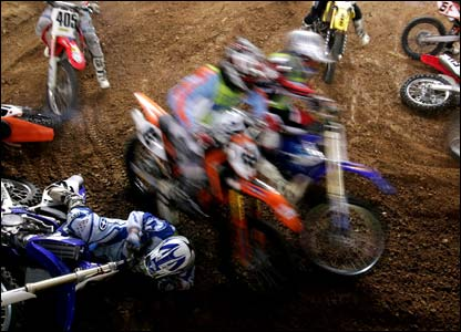 Riders compete in the Athens supercross 2006
