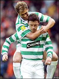 Stilian Petrov congratulates Alan Thompson on his early goal