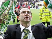 Celtic manager Martin O'Neill celebrates with the trophy
