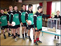 Footballers queue at polling station