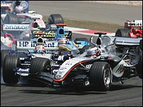 Mark Webber's Williams hits Juan Pablo Montoya's McLaren at the first corner