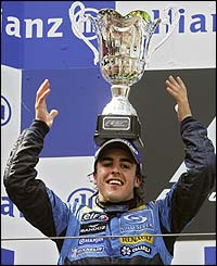 Renault's Fernando Alonso celebrates on the podium