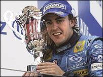 Fernando Alonso celebrates victory in the European Grand Prix