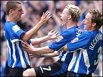 Jon-Paul McGovern (centre) celebrates his opening goal at the Millennium Stadium