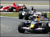 David Coulthard heads for fourth place at the Nurburgring, with Michael Schumacher in the background on the way to fifth