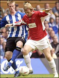 Hartlepool's Ritchie Humphreys (right) was up against his former club and he is challenged by Chris Brunt