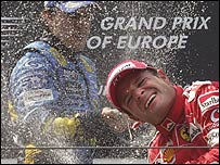 Rubens Barrichello celebrates on the Nurburgring podium with race winner Fernando Alonso