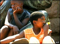 Children sitting on a statue in South Africa
