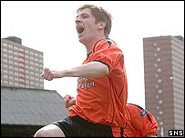Mark Wilson celebrates at Dens Park