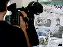 A Japanese television cameraman takes footage outside a hotel in General Santos city in southern Philippines, 28/05/2005