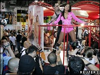 Delegates watch a display at the Adult Entertainment Expo
