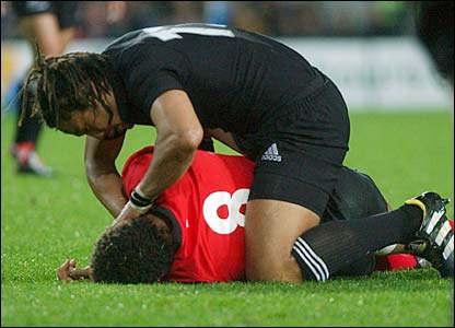 Umaga attends to the unconscious Colin Charvis in the Test against Wales in Hamilton