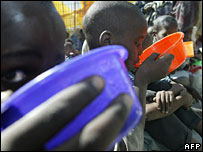 Children drinking porridge as part of a government aid scheme in Kenya.