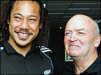 Tana Umaga (L) with New Zealand coach Graham Henry after announcing his retirement