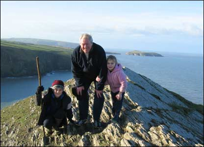 William Charles Frost with his grandchildren, Thomas and Katie Frost, on the top of the mountain at Mwnt (Robert Frost)