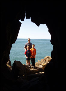 Declan and James with their Dad, Dave Lewis taken from inside St Patrick's Cave, Llanbadrig, Anglesey