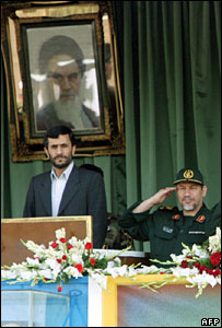 Iranian President Mahmoud Ahmadinejad (L) and Revolutionary Guards Ground Forces Commander Ahmed Kazemi attend a military show in Tehran